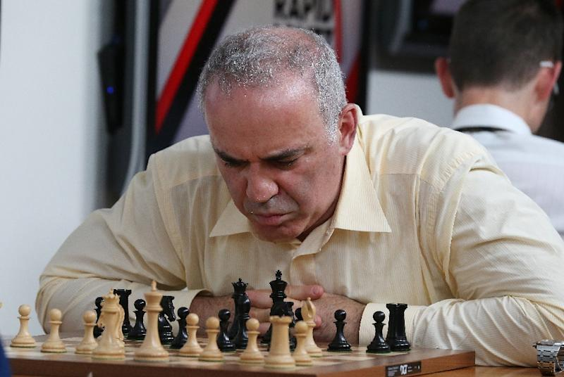 Hundreds of fans from all over the world, young and old, have flocked this weekend to St. Louis, America's chess capital, to see the man who took on IBM's Deep Blue and ruthlessly crushed all human adversaries during the 80s and 90s (AFP Photo/BILL GREENBLATT)