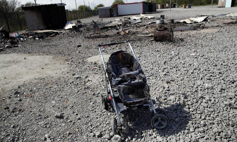 A partially burned pushchair in the remains of the Dunkirk camp.
