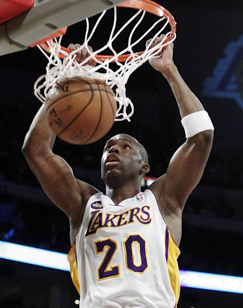 Los Angeles Lakers guard Jodie Meeks (20) dunks against the Sacramento Kings in the first half of an NBA basketball game in Los Angeles, Sunday, March 17, 2013. (AP Photo/Reed Saxon)