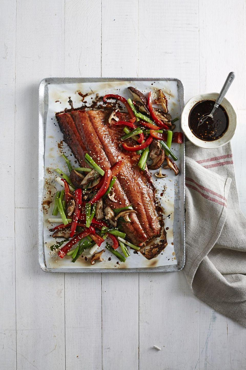 """<p>Peppers and mushrooms are the ideal pairing for sweet and savory honey-soy glazed salmon in this simple, one-pan Christmas dinner. The recipe makes enough for four, but all you need to do is choose a smaller piece of salmon if you're committed to avoiding leftovers.</p><p><em><a href=""""https://www.countryliving.com/food-drinks/recipes/a6126/honey-soy-glazed-salmon-mushrooms-peppers-recipe-clx1214/"""" rel=""""nofollow noopener"""" target=""""_blank"""" data-ylk=""""slk:Get the recipe for Honey-Soy Glazed Salmon with Mushrooms and Peppers »"""" class=""""link rapid-noclick-resp"""">Get the recipe for Honey-Soy Glazed Salmon with Mushrooms and Peppers »</a></em></p>"""
