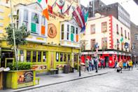 """Sure, the capital city of <a href=""""https://www.cntraveler.com/story/beyond-the-basics-dublin?mbid=synd_yahoo_rss"""" rel=""""nofollow noopener"""" target=""""_blank"""" data-ylk=""""slk:Dublin"""" class=""""link rapid-noclick-resp"""">Dublin</a> has seen a spike in global companies and expats putting down roots, but it maintains its hospitable Irish core. Notably friendly residents give Midwesterners a run for their money, and you never get shoved aside on a busy street; it's par for the course to slow down to a stroll through <a href=""""https://www.cntraveler.com/activities/dublin/st-stephens-green?mbid=synd_yahoo_rss"""" rel=""""nofollow noopener"""" target=""""_blank"""" data-ylk=""""slk:St. Stephen's Green"""" class=""""link rapid-noclick-resp"""">St. Stephen's Green</a>, or linger over a meal at one of the <a href=""""https://www.cntraveler.com/gallery/best-restaurants-in-dublin?mbid=synd_yahoo_rss"""" rel=""""nofollow noopener"""" target=""""_blank"""" data-ylk=""""slk:city's buzzy restaurants"""" class=""""link rapid-noclick-resp"""">city's buzzy restaurants</a>. Nearly every street has (at least) one pub filled with locals and tourists coming together to celebrate life—and that welcoming vibe lasts long after a couple pints."""