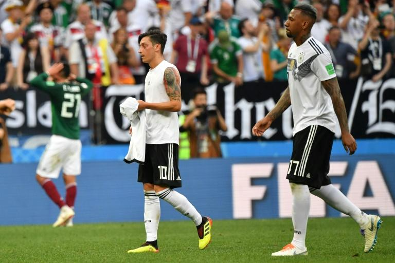 Mesut Ozil (L) took to Instagram to thank his former Germany team-mate defender Jerome Boateng (R) for publically supporting him in the wake of the Arsenal midfielder's controversial retirement from international football