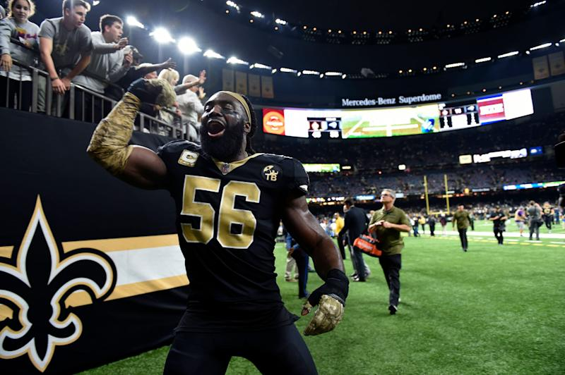 New Orleans Saints outside linebacker Demario Davis (56) celebrates after defeating the Los Angeles Rams in an NFL football game in New Orleans, Sunday, Nov. 4, 2018. The Saints won 45-35. (AP Photo/Bill Feig)
