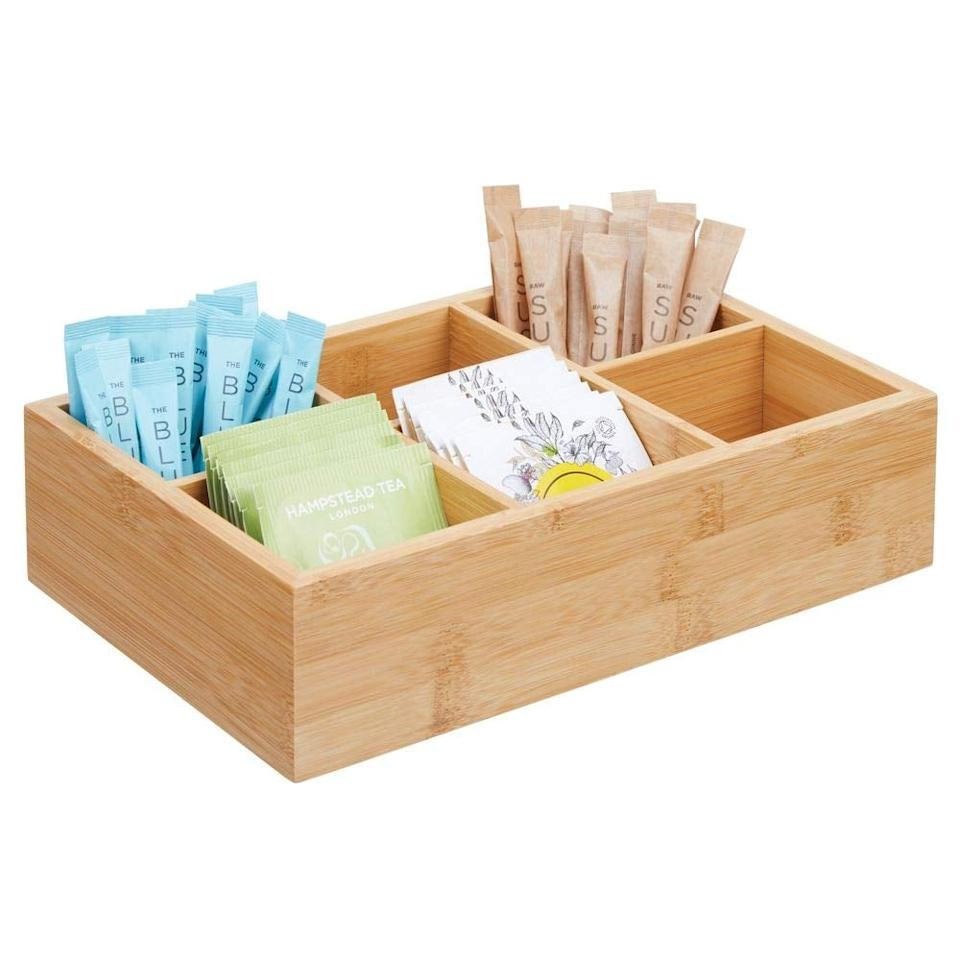 """<p>My cabinets always have random tea bags floating around, but now I can keep them nice and neat with this <a href=""""https://www.popsugar.com/buy/mDesign-Bamboo-Wood-Compact-Tea-amp-Food-Storage-Organizer-Bin-538988?p_name=mDesign%20Bamboo%20Wood%20Compact%20Tea%20%26amp%3B%20Food%20Storage%20Organizer%20Bin&retailer=amazon.com&pid=538988&price=13&evar1=casa%3Aus&evar9=47092931&evar98=https%3A%2F%2Fwww.popsugar.com%2Fhome%2Fphoto-gallery%2F47092931%2Fimage%2F47093162%2FmDesign-Bamboo-Wood-Compact-Tea-Food-Storage-Organizer-Bin&list1=shopping%2Ceditors%20pick%2Corganization%2Ckitchens%2Csmall%20space%20living%2Chome%20organization%2Chome%20shopping&prop13=mobile&pdata=1"""" rel=""""nofollow"""" data-shoppable-link=""""1"""" target=""""_blank"""" class=""""ga-track"""" data-ga-category=""""Related"""" data-ga-label=""""https://www.amazon.com/mDesign-Bamboo-Compact-Storage-Organizer/dp/B07DQC4DDT/ref=sr_1_9?keywords=tea+organizer&amp;qid=1578684348&amp;sr=8-9"""" data-ga-action=""""In-Line Links"""">mDesign Bamboo Wood Compact Tea &amp; Food Storage Organizer Bin</a> ($13).</p>"""