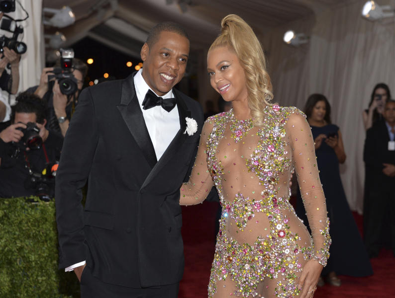 "File - In this May 4, 2015, file photo, Jay Z, left, and Beyonce arrive at The Metropolitan Museum of Art's Costume Institute benefit gala celebrating ""China: Through the Looking Glass"" in New York. Country music power couple Faith Hill and Tim McGraw talk about what they admire about other musical couples, from Beyonce and Jay Z to Garth Brooks and Trisha Yearwood. ""The truth is, I want to be Beyonce every single freaking night of my life,"" Hill said. (Photo by Evan Agostini/Invision/AP, File)"