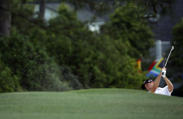 Chris Kirk hits out of a bunker on the first fairway during the fourth round of the Masters golf tournament Sunday, April 13, 2014, in Augusta, Ga. (AP Photo/David J. Phillip)