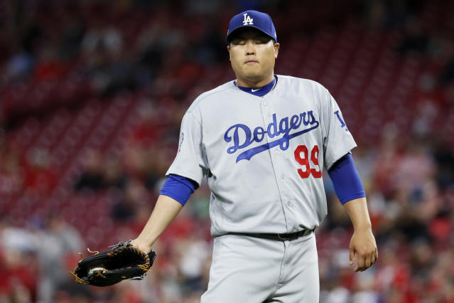 Los Angeles Dodgers starting pitcher Hyun-Jin Ryu reacts in the fourth inning of a baseball game against the Cincinnati Reds, Tuesday, Sept. 11, 2018, in Cincinnati. (AP Photo/John Minchillo)