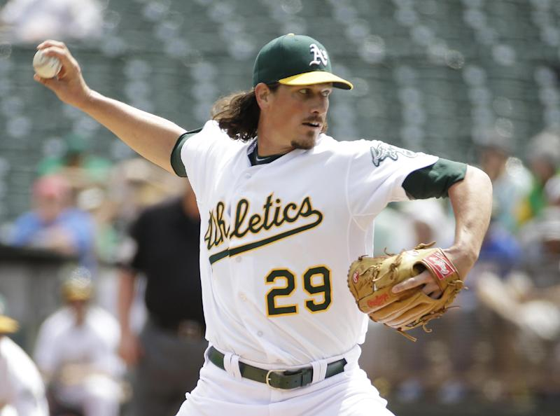 Oakland Athletics starting pitcher Jeff Samardzija throws in the first inning of their interleague baseball game against the New York Mets Wednesday, Aug. 20, 2014, in Oakland, Calif. (AP Photo/Eric Risberg)