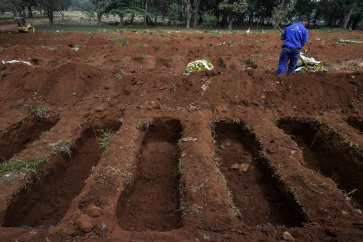 An employee is seen at the Vila Formosa cemetery, in the outskirts of Sao Paulo, Brazil on May 20, 2020, amid the new coronavirus pandemic