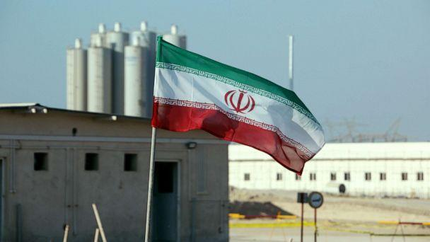 PHOTO: A picture taken, Nov. 10, 2019, shows an Iranian flag in Iran's Bushehr nuclear power plant, during an official ceremony to kick-start works on a second reactor at the facility. (Atta Kenare/AFP via Getty Images, FILE)