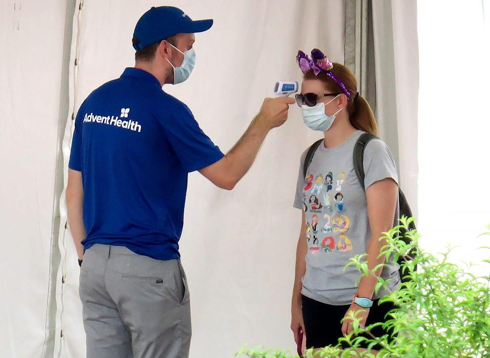 Disney World said it will begin phasing out temperature checks for visitors starting May 16.