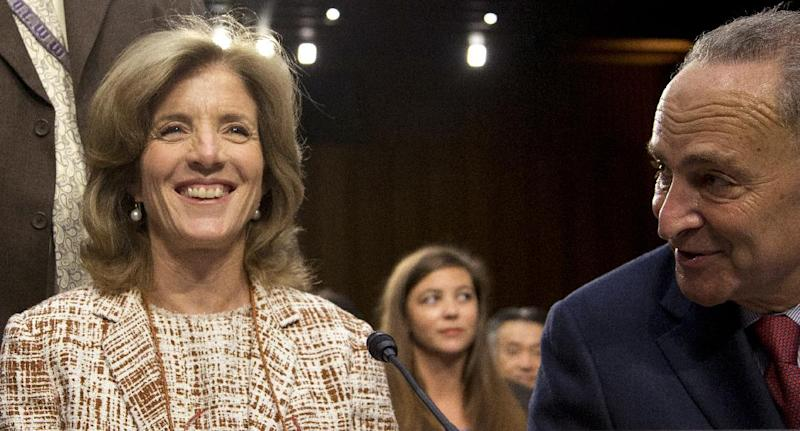 Caroline Kennedy of New York, left, arrives for the Senate Foreign Relations Committee hearing on her nomination for Ambassador to Japan, on Capitol Hill, Thursday, Sept. 19, 2013, in Washington, as Sen. Charles Schumer, D- N.Y., speaks to her at left. Former first daughter Caroline Kennedy said she would be humbled to carry forward her father's legacy if confirmed by the Senate to be the next U.S. ambassador to Japan. (AP Photo/Carolyn Kaster)