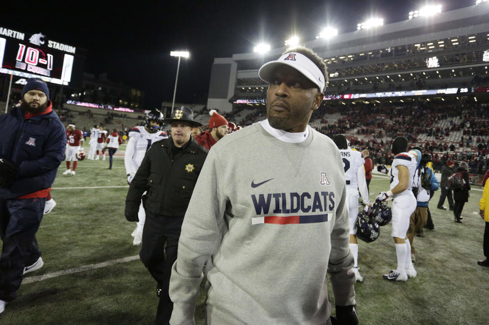 Arizona head coach Kevin Sumlin walks on the field after an NCAA college football game against Washington State in Pullman, Wash., Saturday, Nov. 17, 2018. (AP Photo/Young Kwak)