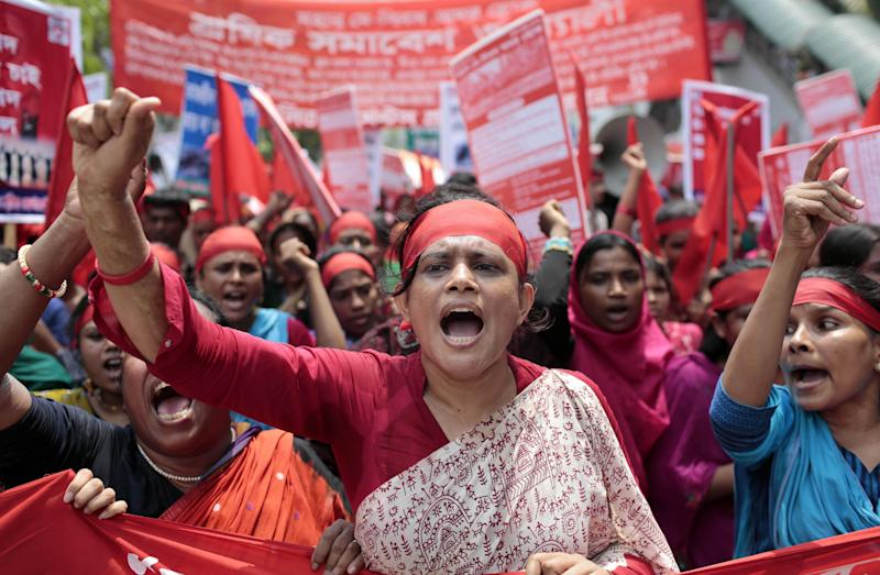 Bangladeshi garment workers and activists shout slogans demanding punishment for owners of garment factories that have had accidents in the past, compensation for victims and ensuring work place safety during a May Day rally in Dhaka, Bangladesh, Thursday, May 1, 2014. (AP Photo/A.M. Ahad)