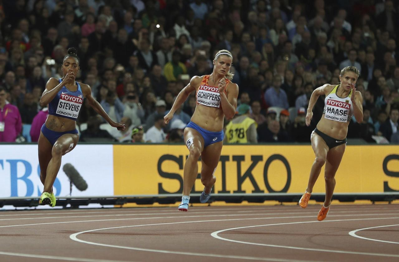 <p>United States' Deajah Stevens, Netherlands' Dafne Schippers and Germany's Rebekka Haase, from left, compete in a women's 200-meter semifinal during the World Athletics Championships in London Thursday, Aug. 10, 2017. (AP Photo/Leonore Schick) </p>