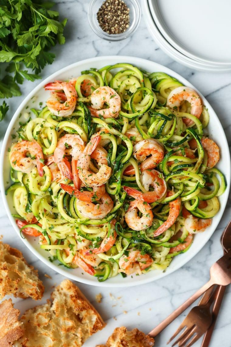 """<p>This colorful dish is light on carbs but not on flavor. Butter, garlic, lemon, and parsley give it a bright, summery taste you'll crave no matter the season.</p> <p><strong>Get the recipe:</strong> <a href=""""https://damndelicious.net/2019/05/08/garlic-butter-shrimp-zucchini-noodles/"""" class=""""link rapid-noclick-resp"""" rel=""""nofollow noopener"""" target=""""_blank"""" data-ylk=""""slk:garlic butter shrimp zucchini noodles"""">garlic butter shrimp zucchini noodles</a></p>"""