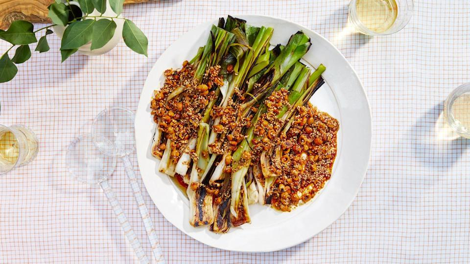 "The glory of these leeks is the contrast between their deeply charred exteriors and jammy, sweet interiors. Pay attention to the hot spots on your grill and move leeks around if they are charring more quickly in some places than others. <a href=""https://www.bonappetit.com/recipe/grilled-leeks-with-brown-butter-and-spiced-hazelnuts?mbid=synd_yahoo_rss"" rel=""nofollow noopener"" target=""_blank"" data-ylk=""slk:See recipe."" class=""link rapid-noclick-resp"">See recipe.</a>"