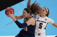 Georgia Tech forward Lorela Cubaj (13) grabs a rebound in front of South Carolina forward Victaria Saxton (5) during the first half of a college basketball game in the Sweet Sixteen round of the women's NCAA tournament at the Alamodome in San Antonio, Sunday, March 28, 2021. (AP Photo/Eric Gay)