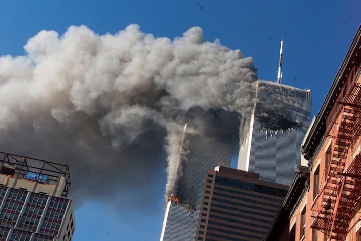 In this Sept. 11, 2001, file photo, smoke rises from the burning twin towers of the World Trade Center after hijacked planes crashed into the towers, in New York City.