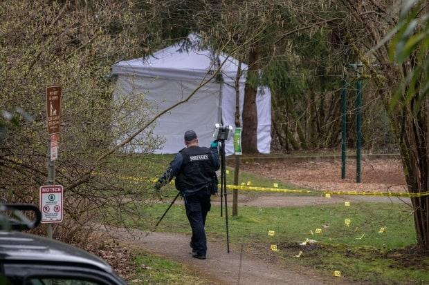 A white tent covers the area where human remains were found in a Burnaby, B.C., park on March 18, 2021. (Ben Nelms/CBC - image credit)
