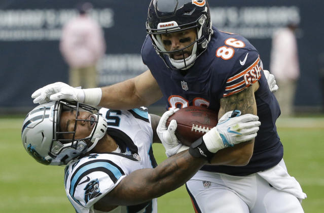 <p>Chicago Bears tight end Zach Miller (86) stiff arms Carolina Panthers linebacker Shaq Green-Thompson (54) during the first half of an NFL football game, Sunday, Oct. 22, 2017, in Chicago. (AP Photo/Charles Rex Arbogast) </p>