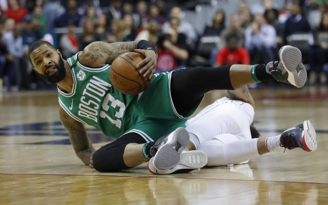 Boston Celtics forward Marcus Morris (13) beats out Washington Wizards forward Kelly Oubre Jr. (12) for the ball during the first half of an NBA basketball game Thursday, Feb. 8, 2018, in Washington. (AP Photo/Pablo Martinez Monsivais)