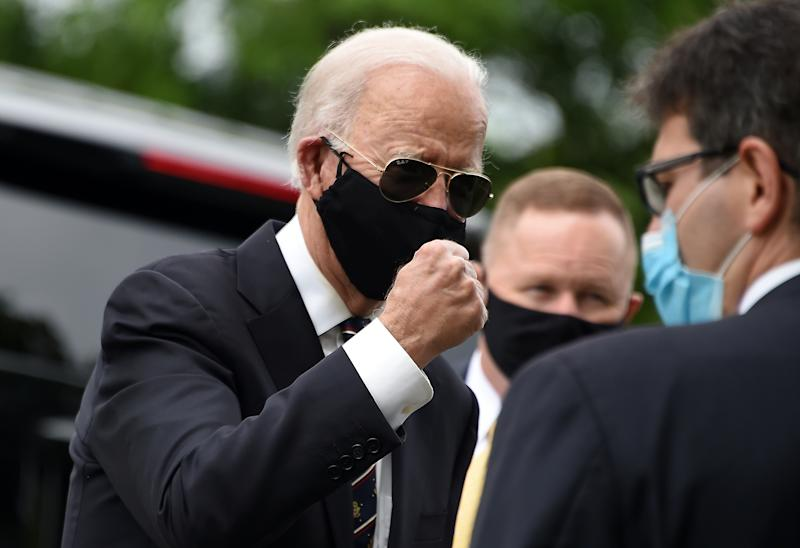 Democratic presidential candidate and former US Vice President Joe Biden gestures while speaking to people at the Delaware Memorial Bridge Veteran's Memorial Park in New Castle, Delaware, May 25, 2020. - Joe Biden, the presumptive Democratic presidential nominee, emerged from more than two months of seclusion Monday, wearing a black face mask during a visit to lay a wreath on the day the United States honors its war dead. Biden's last public appearance was March 15 when he faced off against his former Democratic rival Bernie Sanders for a debate in a television studio held with no live audience. (Photo by Olivier DOULIERY / AFP) (Photo by OLIVIER DOULIERY/AFP via Getty Images)