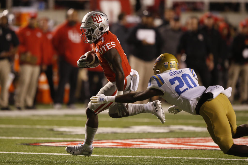 Utah running back Devonta'e Henry-Cole (7) out runs UCLA defensive back Elisha Guidry (20) on his way to a touchdown in the second half during an NCAA college football game Saturday, Nov. 16, 2019, in Salt Lake City. (AP Photo/Rick Bowmer)