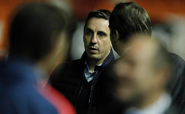 Valencia's coach Gary Neville looks on before the Spanish league football match Valencia CF vs Real Madrid CF at the Mestalla stadium in Valencia on January 3, 2016 (AFP Photo/Jose Jordan)