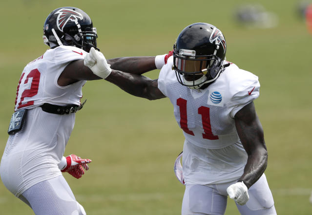 Atlanta Falcons wide receiver Julio Jones (11) works against fellow receiver Mohamed Sanu (12) during NFL football training camp, Tuesday, Aug. 7, 2018, in Flowery Branch, Ga. (AP Photo/John Bazemore)