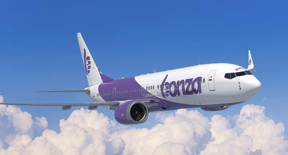 A photo of a purple and white Bonza aircraft flying in the sky.