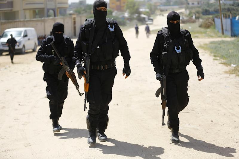 Hamas security force members carry out a raid in the Gaza Strip that results in the arrest of a suspect in a recent bomb attack against the Palestinian prime minister but leaves two of their colleagues dead (AFP Photo/MOHAMMED ABED)