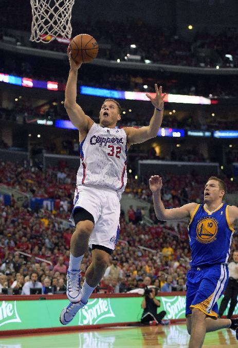 Los Angeles Clippers forward Blake Griffin, left, goes up for a shot as Golden State Warriors forward David Lee defends during the first half in Game 7 of an opening-round NBA basketball playoff series, Saturday, May 3, 2014, in Los Angeles. (AP Photo/Mark J. Terrill)