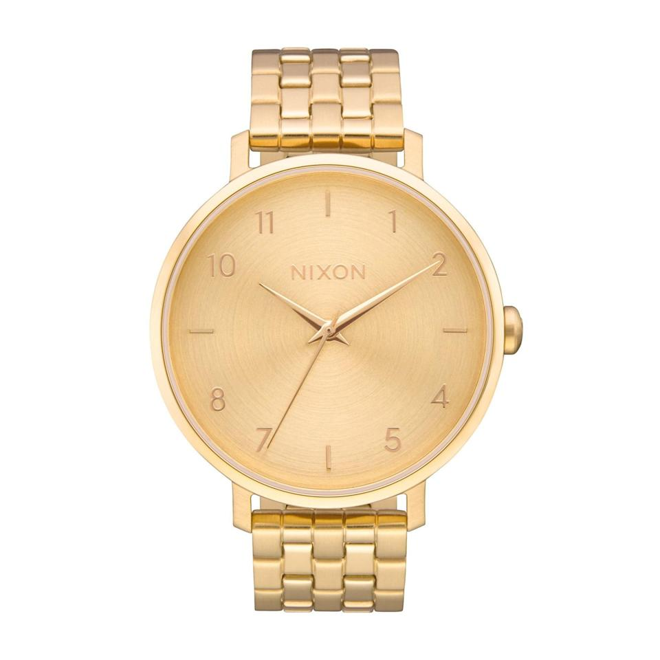 """Into the monochromatic look? Nixon is a staple for timeless, pared-back watches, like this gold-on-gold chain piece. $200, Nordstrom. <a href=""""https://www.nordstrom.com/s/nixon-the-arrow-bracelet-watch-38mm/5835995?origin=category-personalizedsort&breadcrumb=Home%2FBrands%2FNixon%2FWomen&color=gold"""" rel=""""nofollow noopener"""" target=""""_blank"""" data-ylk=""""slk:Get it now!"""" class=""""link rapid-noclick-resp"""">Get it now!</a>"""