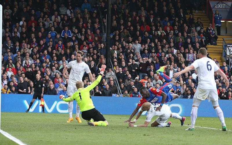 Christian Benteke equalises for Palace against Leicester in a match that finished 2-2 - Rex Features