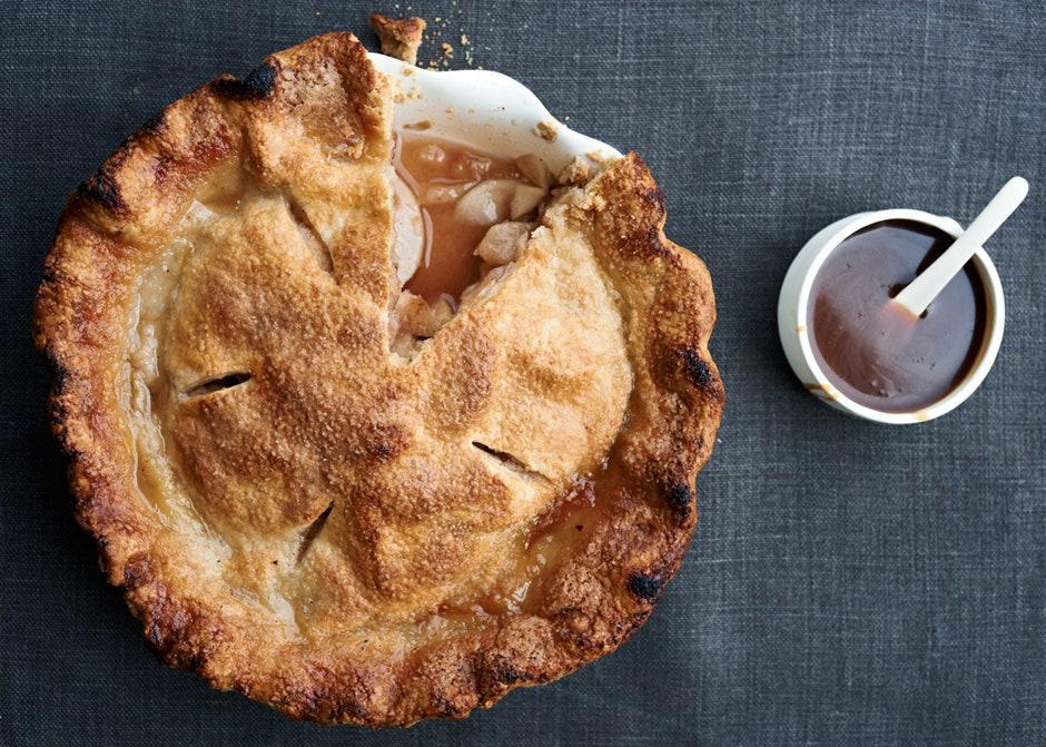 """A little cider vinegar in the filling keeps this apple pie from being too sweet. <a href=""""https://www.bonappetit.com/recipe/apple-pie-with-spiced-apple-caramel-sauce?mbid=synd_yahoo_rss"""" rel=""""nofollow noopener"""" target=""""_blank"""" data-ylk=""""slk:See recipe."""" class=""""link rapid-noclick-resp"""">See recipe.</a>"""