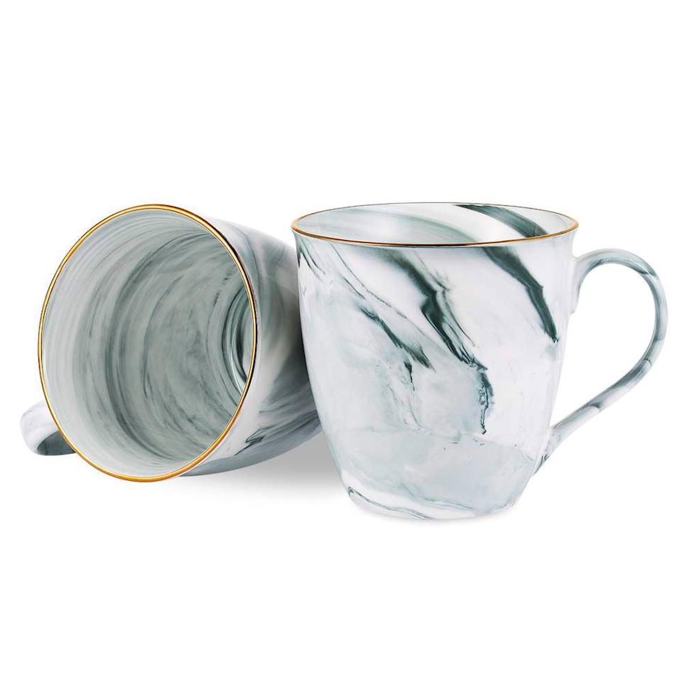 """<p>Help your gal pal instantly elevate her morning coffee habit with this set of chic marbled mugs. Available in gray, cream, or flamingo pink, each set of mugs is an excuse to caffeinate as often as necessary.</p> <p><strong>To buy:</strong> $23 for 2, <a href=""""https://www.amazon.com/dp/B07SSWLHHB/ref=as_li_ss_tl?ie=UTF8&linkCode=ll1&tag=rsggbffgiftguidersylvesteroct19-20&linkId=fa169efd12cb6b991b6a9be6ab43f28e&language=en_US"""" target=""""_blank"""">amazon.com</a>.</p>"""