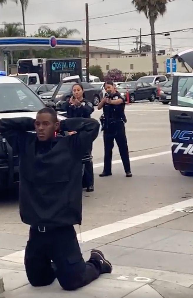 The Hawthorne Police Department stopped a man who mini-mart employees accused of assault and robbery. The man dropped to his knees while police had their guns drawn. (Photo: Courtesy of Sky Holsey)