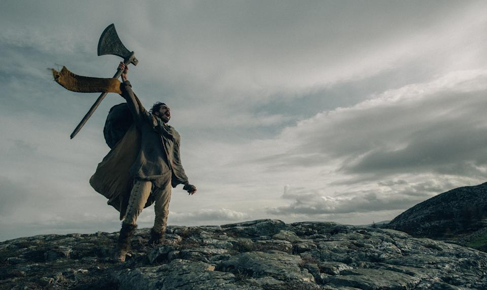 """Gawain (Dev Patel) takes a mighty axe on an epic quest in the Arthurian fantasy tale """"The Green Knight."""""""