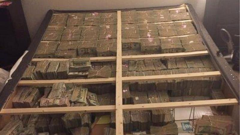 Photo Shows $20M That Feds Found Hidden in Bed