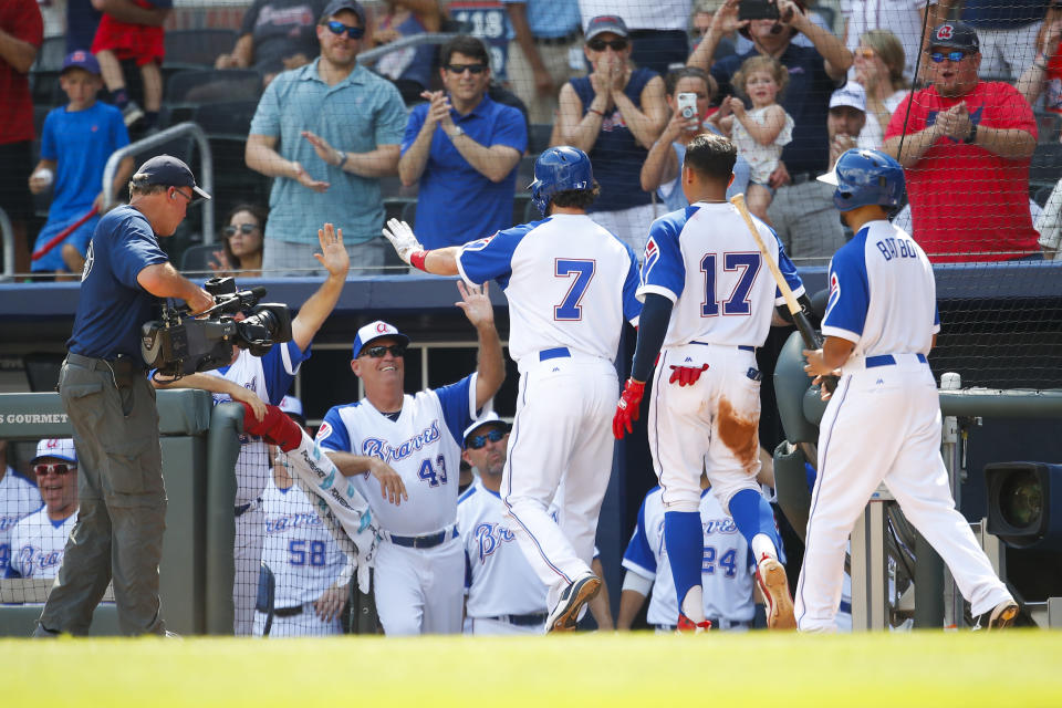 Atlanta Braves' Dansby Swanson (7) celebrates his two-run home run with teammates in the eighth inning of a baseball game against the Baltimore Orioles, Sunday, June 24, 2018, in Atlanta. (AP Photo/Todd Kirkland)