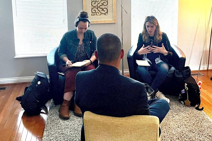 Dispatch reporters Sheridan Hendrix, left, and Céilí Doyle, right, interview Randy Sroufe, center, at his home in Cincinnati, Ohio on Wednesday, May 12, 2021.