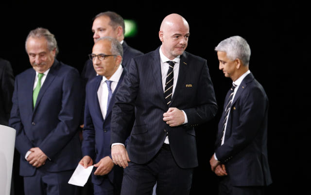 FIFA President Gianni Infantino walks past North America soccer officials at the FIFA congress on the eve of the opener of the 2018 soccer World Cup in Moscow, Russia, Wednesday, June 13, 2018. The congress in Moscow is set to choose the host or hosts for the 2026 World Cup. (AP Photo/Alexander Zemlianichenko)