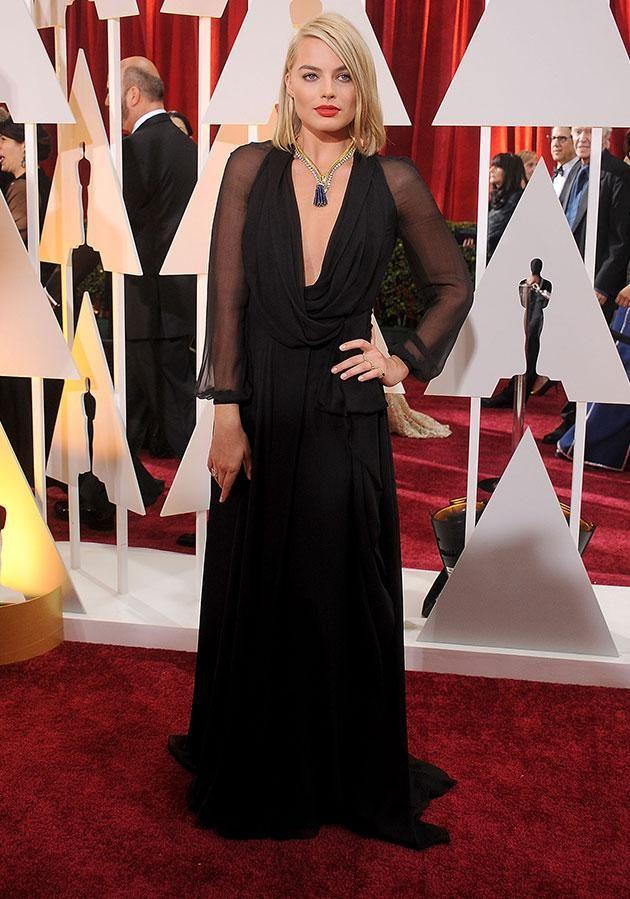 Some of Hollywood's biggest names are set to protest at the Golden Globes in January by wearing black. Margot Robbie pictured at the 2015 Oscars. Source: Getty