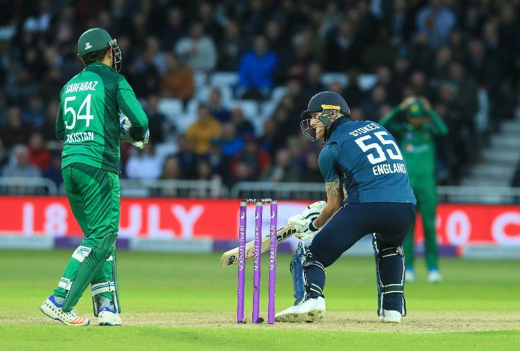 Deft touch -- Ben Stokes plays a cut shot during his match-winning 71 not out in the fourth ODI in Nottingham as Pakistan captain and wicket-keeper Sarfraz Ahmed looks on (AFP Photo/Lindsey PARNABY)