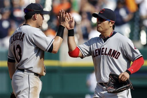Cleveland Indians shortstop Asdrubal Cabrera (13) and right fielder Shin-Soo Choo, of South Korea, celebrate after defeating the Detroit Tigers 3-2 in a baseball game in Detroit, Monday, Sept. 3, 2012. (AP Photo/Paul Sancya)