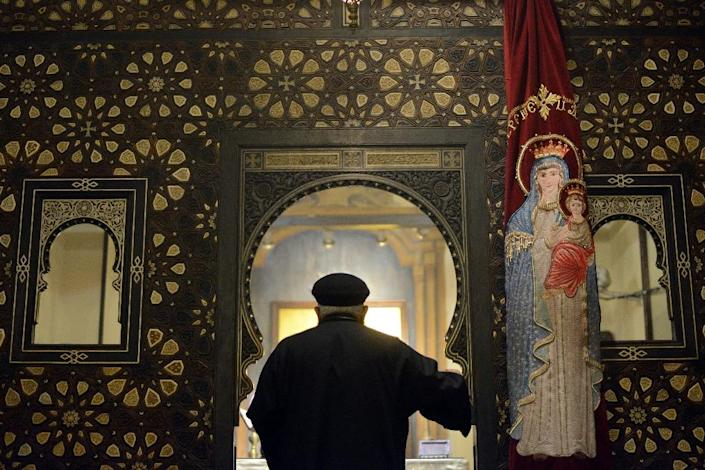 Copts, who make up about 10 percent of Egypt's population of 90 million, have faced persecution and discrimination that spiked during the 30-year rule of Hosni Mubarak, who was toppled by a popular uprising in 2011. (AFP Photo/Mohamed El-Shahed)