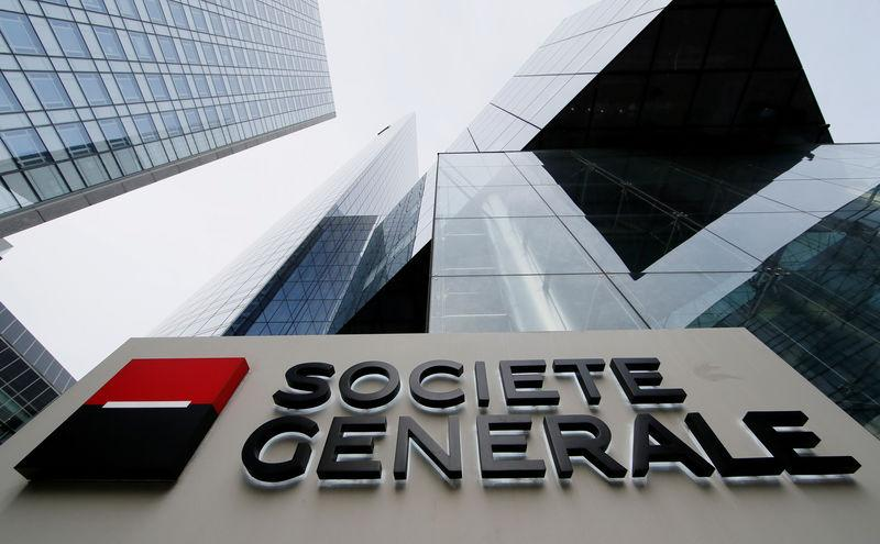FILE PHOTO: The logo of the French bank Societe Generale is seen in front of the bank's headquarters building at La Defense business and financial district in Courbevoie near Paris