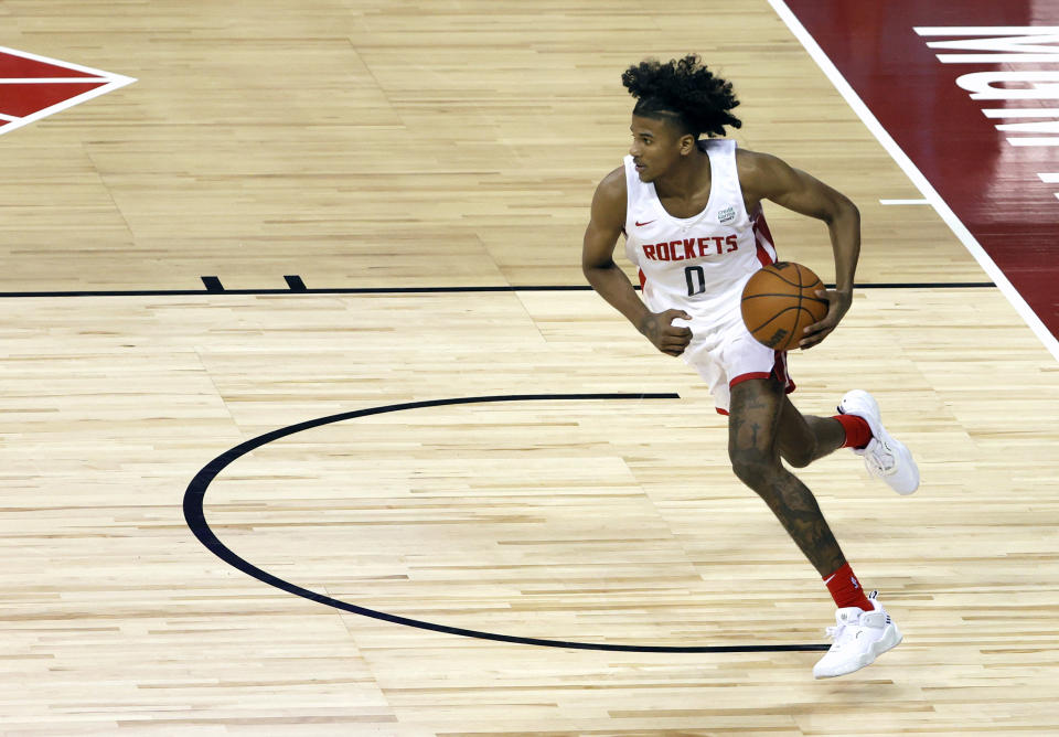 LAS VEGAS, NEVADA - AUGUST 10:  Jalen Green #0 of the Houston Rockets brings the ball up the court against the Detroit Pistons during the 2021 NBA Summer League at the Thomas & Mack Center on August 10, 2021 in Las Vegas, Nevada. The Rockets defeated the Pistons 111-91. NOTE TO USER: User expressly acknowledges and agrees that, by downloading and or using this photograph, User is consenting to the terms and conditions of the Getty Images License Agreement. (Photo by Ethan Miller/Getty Images)