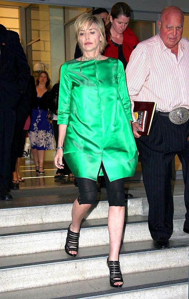 "Sharon Stone is fierce for 51, but this matronly green muumuu is far from flattering. Greg Tidwell/<a href=""http://www.pacificcoastnews.com/"" target=""new"">PacificCoastNews.com</a> - April 14, 2009"